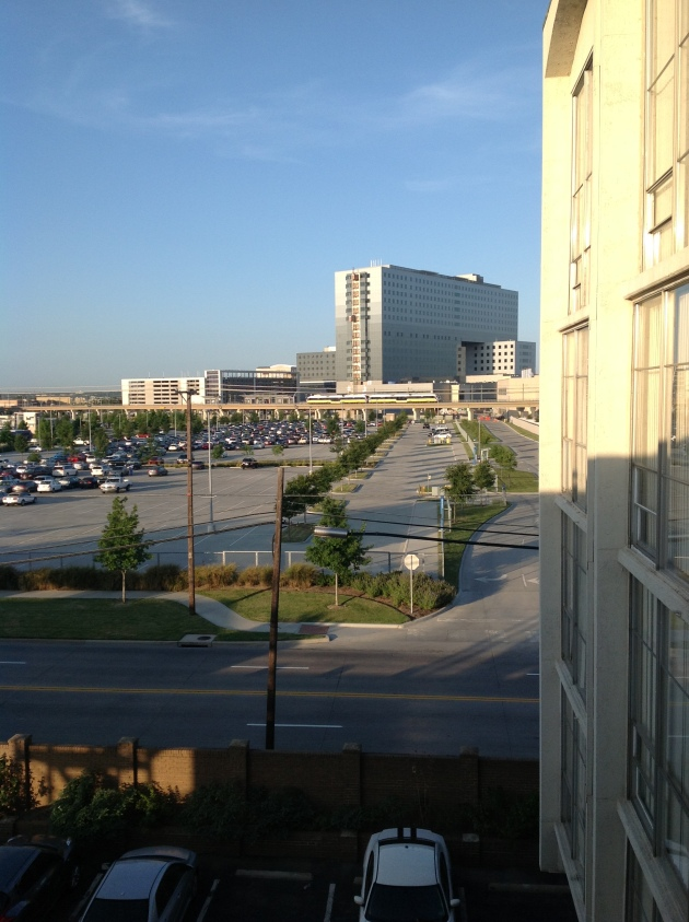 Towne Square Apartments; Employee Parking Lot; DART line rail (with yellow train); New Parkland Hospital. Can the urb be renewed?