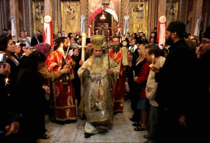 Greek Orthodox Patriarch of Jerusalem Theophilos III leads the Easter Sunday mass at the Church of the Holy Sepulchre