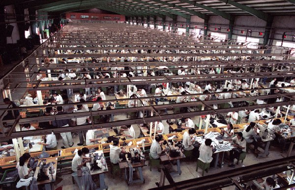 A Nike sweatshop, China. The flunkeys and their Crash.