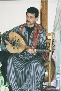 . . . the Arab musician Plucks the lute strings With an eagle quill . . .